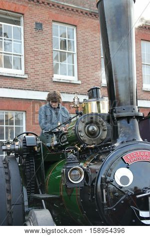 26TH NOVEMBER 2016, PORTSMOUTH DOCKYARD,ENGLAND; An owner with his steam engine at the yearly Victorian Christmas festival in Portsmouth dockyard, England, 26th November 2016