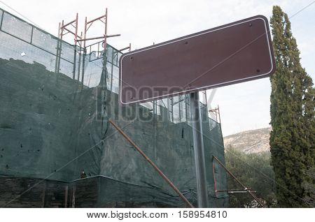 metal board in construction site, greece, imitos mountain