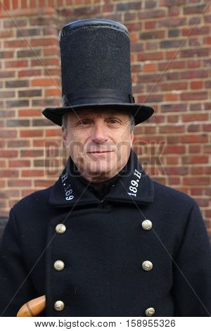 26TH NOVEMBER 2016, PORTSMOUTH DOCKYARD, ENGLAND:An unknown actor playing the part of a victorian policeman at the yearly Christmas victorian festival in portsmouth dockyard,england,26th november 2016