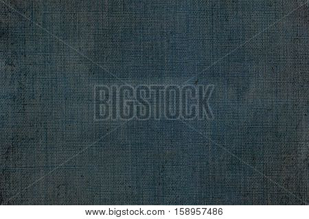 woven canvas background texture of blue jeans fabric