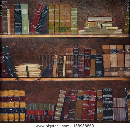 Aged classic books on old wooden shelves