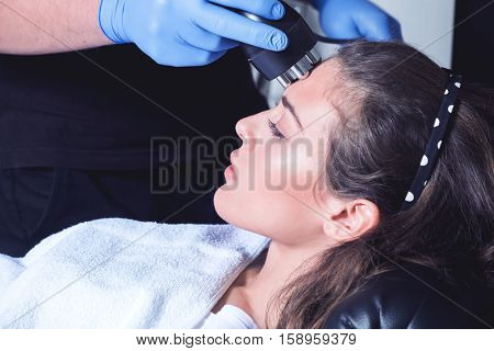 woman face treatment at medical spa center