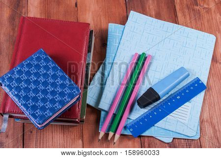 School and office supplies on a wooden table