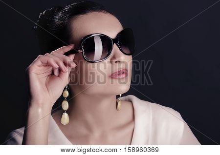 Yong lady, elegant woman, cute girl in a studio