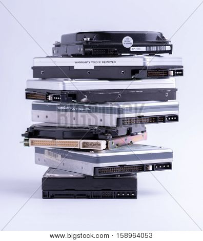 Pile of old hard drive on white background.