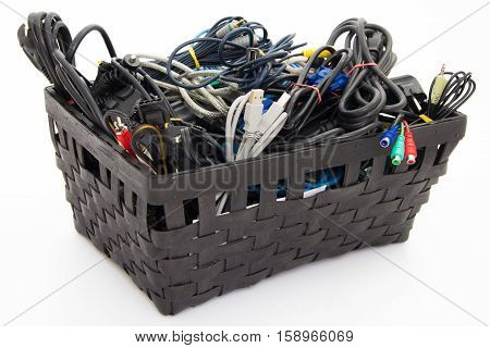 Big pile of computer cables neatly sorted in box - basket - isolated on white