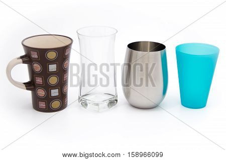 Different materials for cups, mugs, glasses - Plastic, metal (stainless steel), glass, ceramic - isolated on white