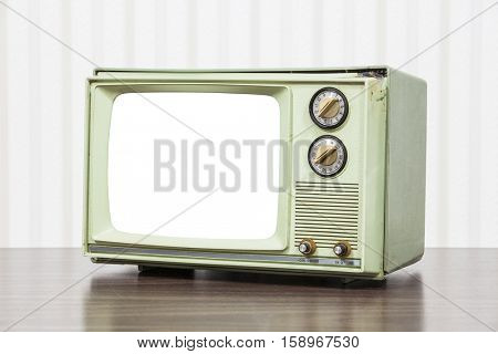 Green vintage television with cut out screen.