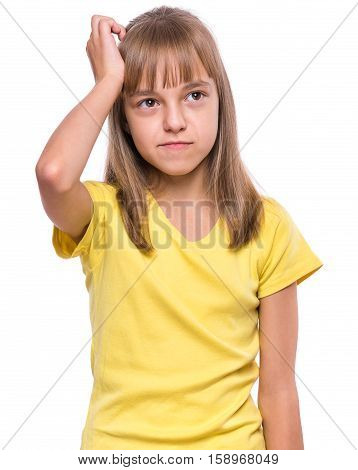 Casual thinking girl - caucasian female model. Half-length emotional portrait of child wearing yellow t-shirt. Thoughtful kid, isolated on white background. Beautiful smart serious ponder children.