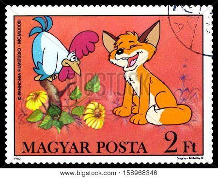 STAVROPOL RUSSIA - November 28 2016: A stamp printed in Hungary shows Pup and Rooster - heroes childlike TV programs cartoons series circa 1982