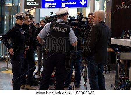 Frankfurt am Main, Germany - November 29, 2016: Police and journalists in Frankfurt airport during Lufthansa pilot strike.