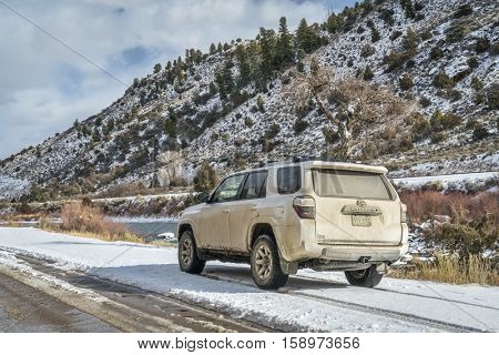 BURNS, CO, USA - NOVEMBER 27, 2016:  Winter travel on a dirt road along Colorado River with Toyota 4Runner SUV (2016 Trail edition).