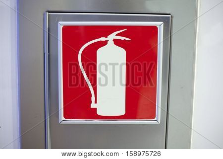 One wall mounted aluminum box for fire extinguisher with red icon extinguisher