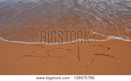 2017 written on sand at sunset. 2017 lettering on the beach.