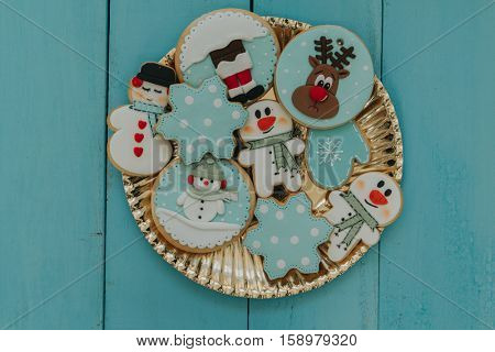 Tasty cookies for Christmas in blue tones on a wooden background