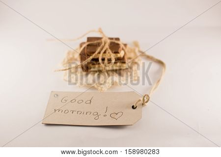 good morning note chocolate on a white background