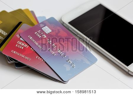 smartphone and credit card on white background online shopping.