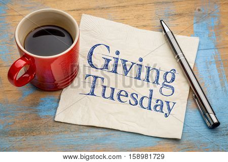 Giving Tuesday concept - handwriting on a napkin with a cup of espresso coffee