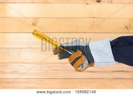 Hand In Glove Holding Screwdriver