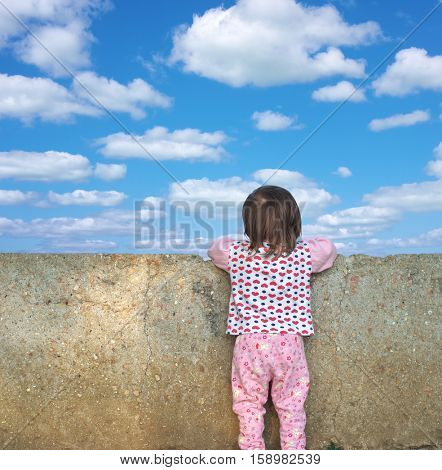 Little girl looking for a wall. Conceptual design.