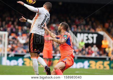 VALENCIA, SPAIN - NOVEMBER 20th: (L) Rodrigo during La Liga soccer match between Valencia CF and Granada CF at Mestalla Stadium on November 20, 2016 in Valencia, Spain