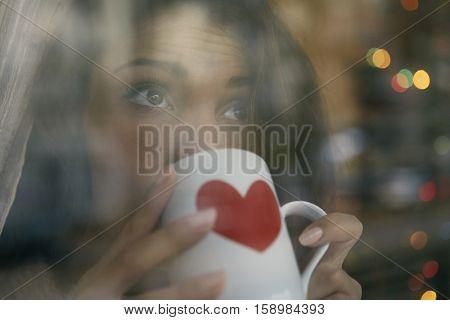 Girl enjoying a hot drink