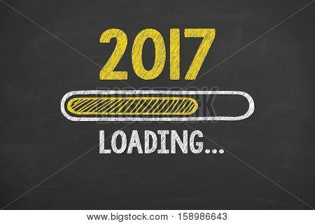 New Year 2017 Loading Technology on Chalkboard Background