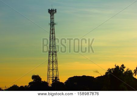 Sunset cell phone tower in the countryside