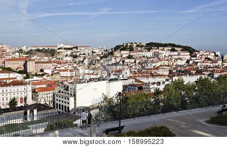 LISBON, PORTUGAL - October 1, 2016: View over the old town center and the medieval Saint George Castle from Sao Pedro de Alcantara lookout point in Lisbon Portugal