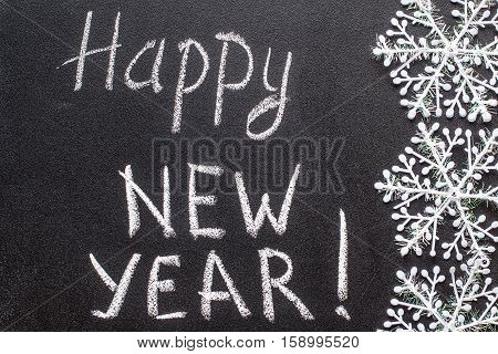 Happy New Year 2016 chalk text on blackboard, new year concept