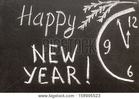 Happy new year 2017, hand writing with chalk on blackboard, vintage concept