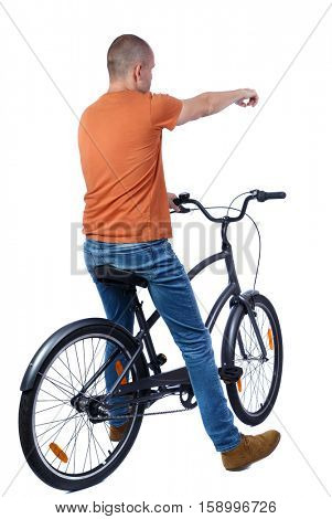 back view of pointing man with a bicycle. cyclist sits on the bike.  Rear view people collection.  backside view of person. Isolated over white background. Shorthair guy on the bike led shows hand up.