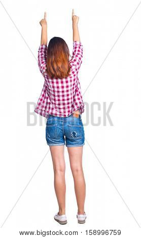 Back view of  pointing woman. beautiful girl. Rear view people collection.  backside view of person.  Isolated over white background. Girl in shorts and checkered shirt shows two hands up.