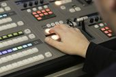 Tv Editor Working With Audio Video Mixer In A Television Broadcast poster