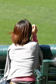 stock photo of groupies  - in ichiros corner of the outfield a female admirer waits for the perfect photo - JPG