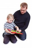 Vather And Son Playing With Magnetic Board