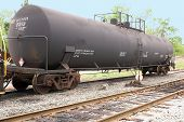 image of railcar  - A train tanker car on a railroad track - JPG