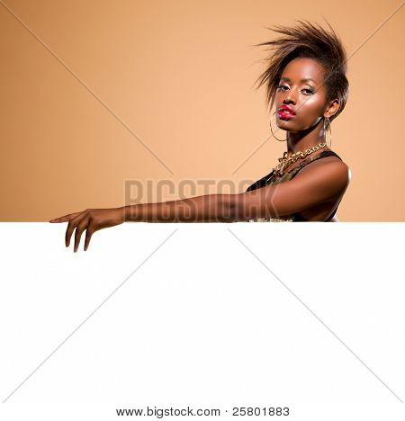 Attractive black woman model standing behind large white banner
