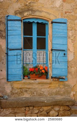 Provencal window with a vase of