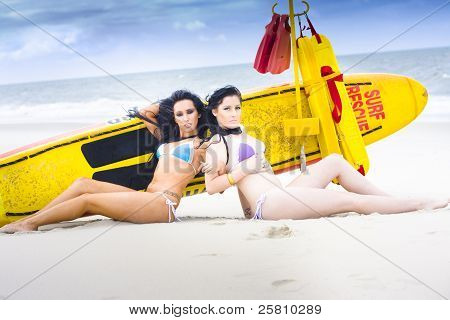 Two Beautiful Women Together On Beach