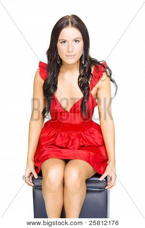 Cute Woman Sitting Thinking And Dreaming In Red Dress