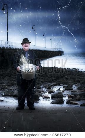 Elderly Fisherman Holding A Bucket Of Fish