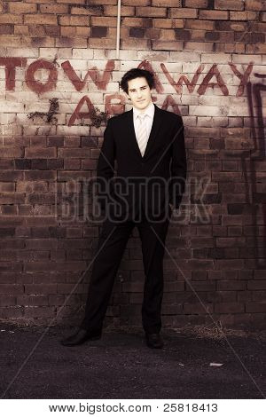 Vintage Salesman Standing In Front Of Brick Wall