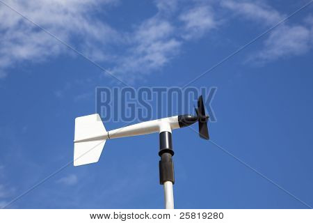 wind wheel or anemometer with cloud background