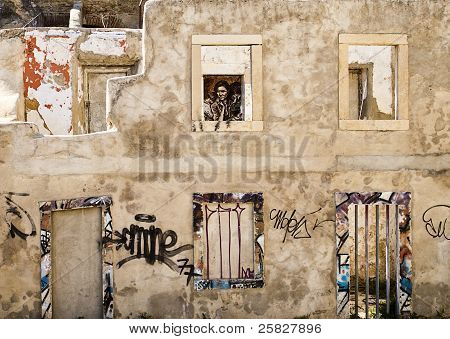 Ruined Building With Migrant Mother