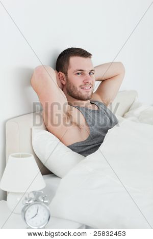 Portrait of a man waking up in his bedroom