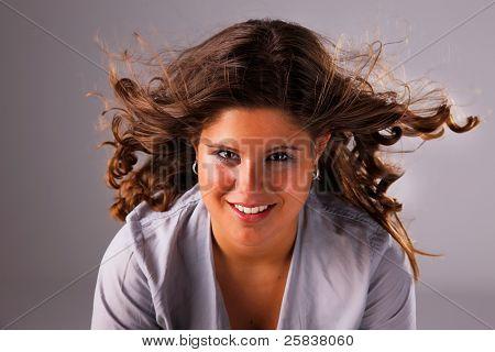Beautiful Woman With Hair On Wind, Studio Shot