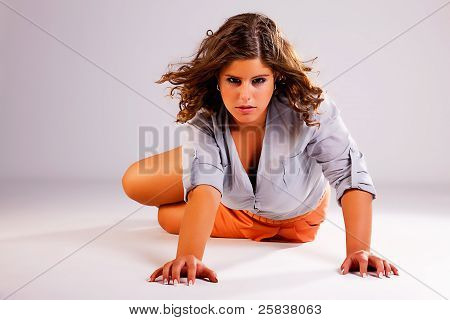 Beautiful Woman On Floor, Studio Shot