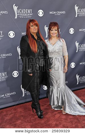 LAS VEGAS - APRIL 3 - Wynonna Judd and Naomi Judd of The Judds attend the 46th Annual Academy of Country Music Awards in Las Vegas, Nevada on April 3, 2011.