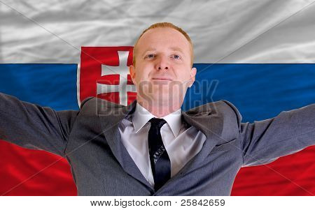 Happy Businessman Because Of Profitable Investment In Slovakia Standing Near Flag
